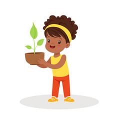 sweet little girl standing and holding a plant in vector image