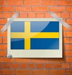 Flags sweden scotch taped to a red brick wall vector