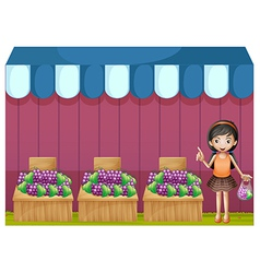 A girl selling grapes vector image vector image