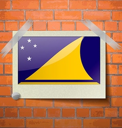Flags tokelau scotch taped to a red brick wall vector