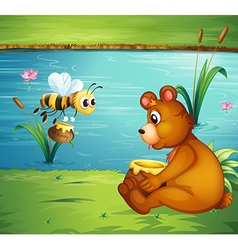 A bear and a bee at the riverbank vector image