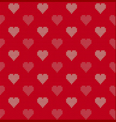 Seamless knitted background with hearts vector