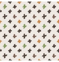 Seamless pattern of colorful hand-painted crosses vector