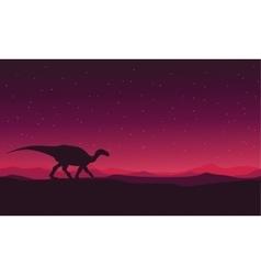 Landscape Iguanodon silhouettes vector image