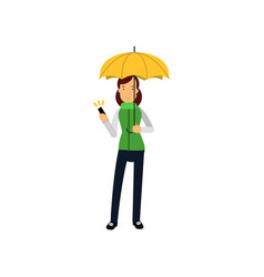 young woman standing under yellow umbrella vector image vector image