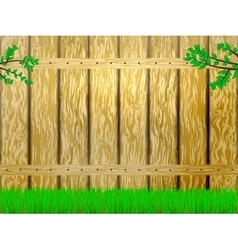 Yellow wooden fence and green grass vector