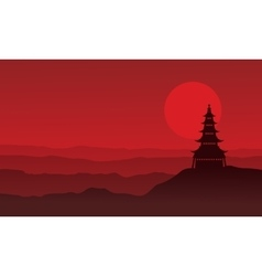 Silhouette of pagoda with moon scenery vector