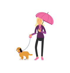 young blonde woman with dog walking under umbrella vector image