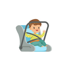 Cute little boy sitting in car seat safety car vector