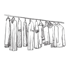 Hand drawn clothes on the hangers vector
