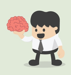 Businessman hold brain vector