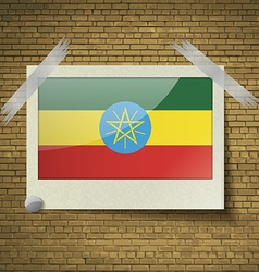 Flags Ethiopia at frame on a brick background vector image