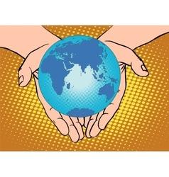 Planet Earth in hands Eurasia Africa Australia vector image vector image