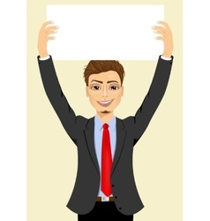 Businessman holding white blank board vector