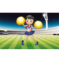 A cheerer with a yellow pompom vector image