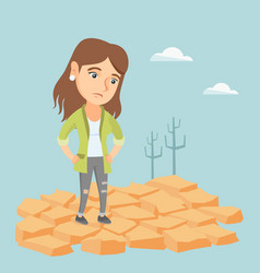 Sad woman standing on cracked earth in the desert vector