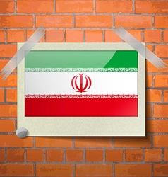 Flags iran scotch taped to a red brick wall vector