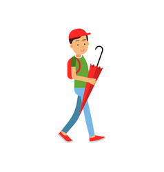 boy with backpack walking with red umbrella vector image vector image