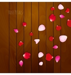 Realistic rose petals on wooden background vector