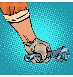 Hand and working the wrench vector