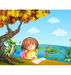 A girl reading beside the river vector image