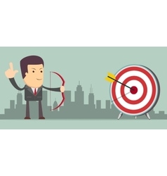 Successful businessman with arrow in the target vector