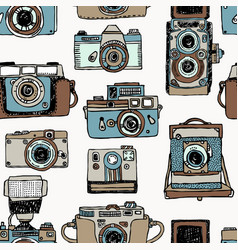 Seamless pattern with old fashioned cameras vector