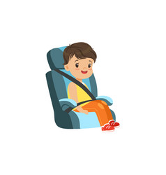 Cute little boy sitting in blue car seat safety vector