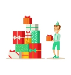 Boy next to giant pile of presents kids birthday vector