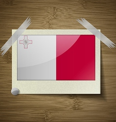 Flags malta at frame on wooden texture vector