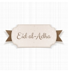 Eid al-adha text on paper badge vector
