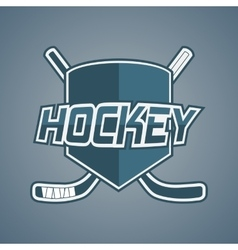Blue hockey team logo with sticks and shield vector