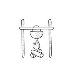 Cooking in cauldron on campfire sketch icon vector image vector image