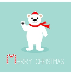 Big white polar bear in santa claus hat and scarf vector