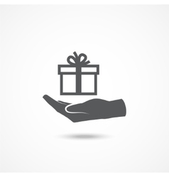 Hand and gift icon vector image vector image