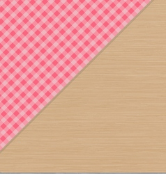 Pink checkered tablecloth on light brown wooden vector