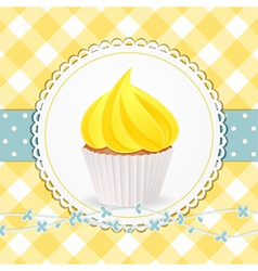 cupcake with yellow icing on yellow gingham vector image