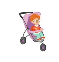 Adorable little boy sitting in modern stroller vector