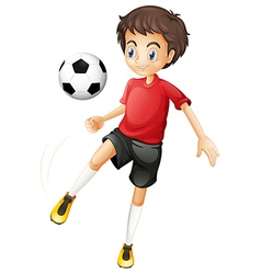 A young man playing football vector image
