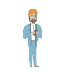 Hindu businessman holding a mobile phone vector