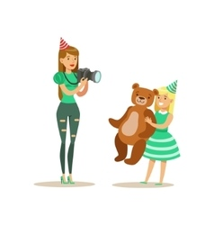 Woman taking pictures with girl and teddy bear vector