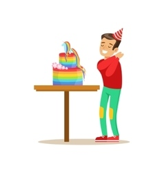 Boy enjoying rainbow cake kids birthday party vector