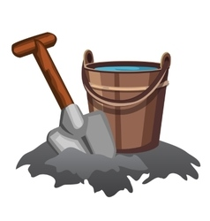 bucket of water and shovel in the ground vector image