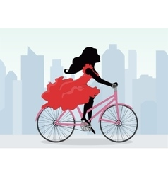 Woman rides a bicycle on the background of the vector
