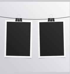 Retro photo frames on rope vector