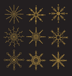 geometric golden snowflakes on black background vector image