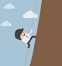 Businessman climbing on the rocks vector image