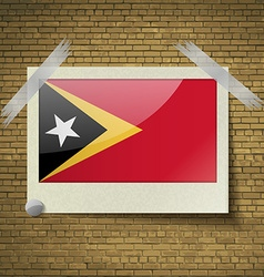 Flags east timor at frame on a brick background vector