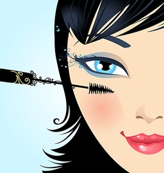 Woman paints the eyelashes makeup mascara vector