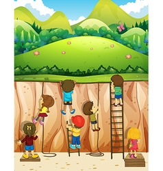 Children climbing up the cliff vector